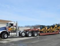 Delivery Truck with Skid Steers