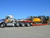 Delivery truck with excavator