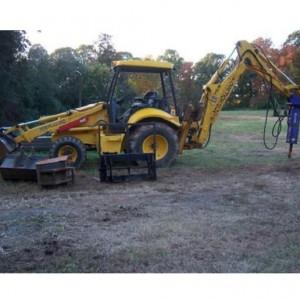Front End Loader/Backhoe - 8,000 lb w/ 500 lb Hydraulic Hammer